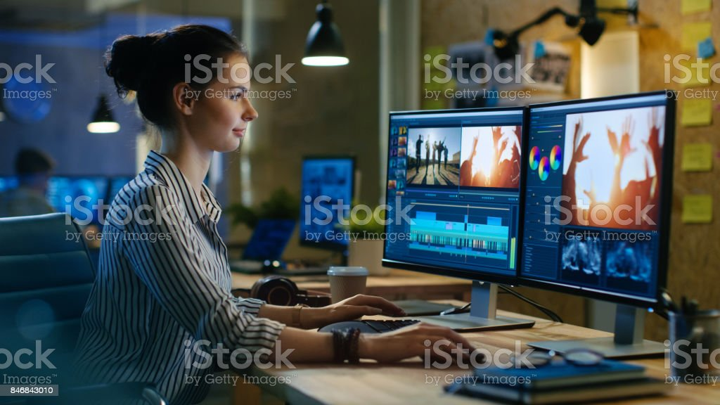 Beautiful Female Video Editor Works with Footage on Her Personal Computer, She Works in Creative Office Studio. royalty-free stock photo