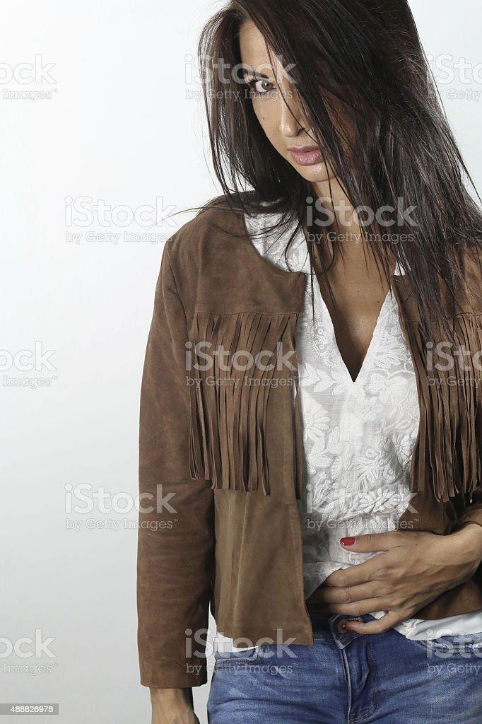 beautiful female wearing a suede jacket stock photo
