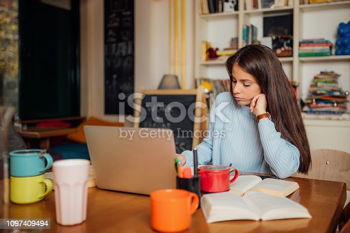 istock Beautiful female with brown hair at the office 1097409494