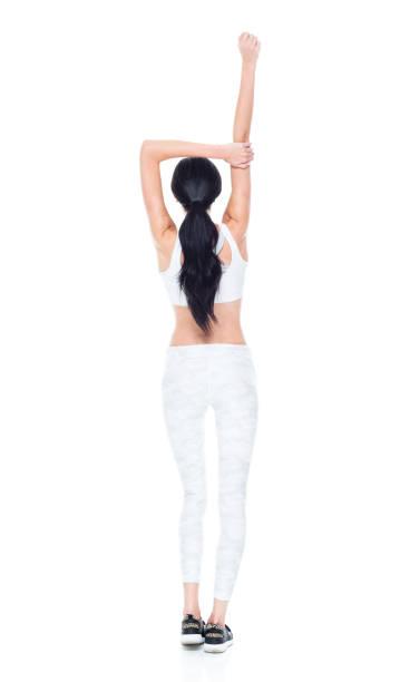 schöne hündin mit langen haaren trägt sportkleidung - damen hosen größe 27 stock-fotos und bilder