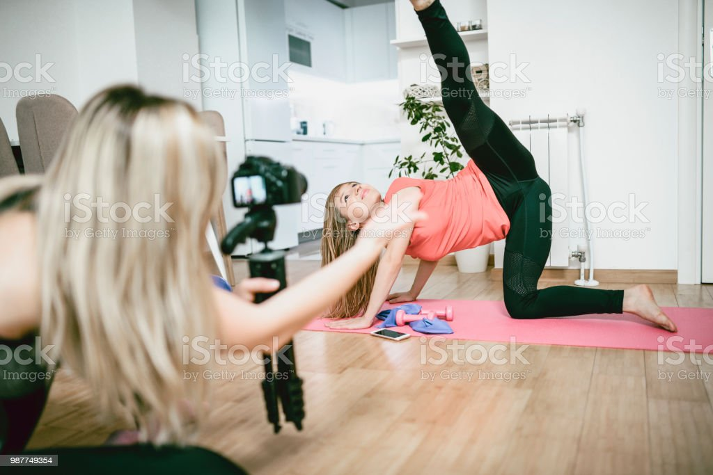 Beautiful Females Making A Home Vlog About Exercising And Healthy Lifestyle stock photo