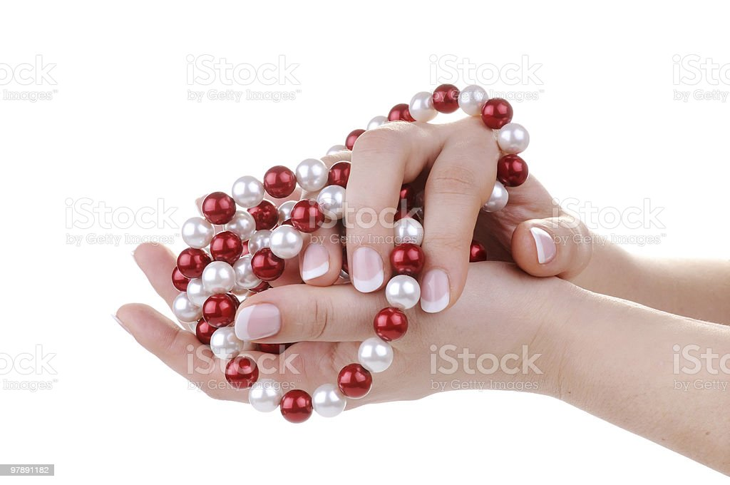 Beautiful feminine hands with necklace royalty-free stock photo