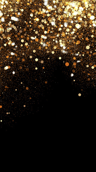 Beautiful festive background of golden confetti. Can be used to create a background for New Years or other holidays