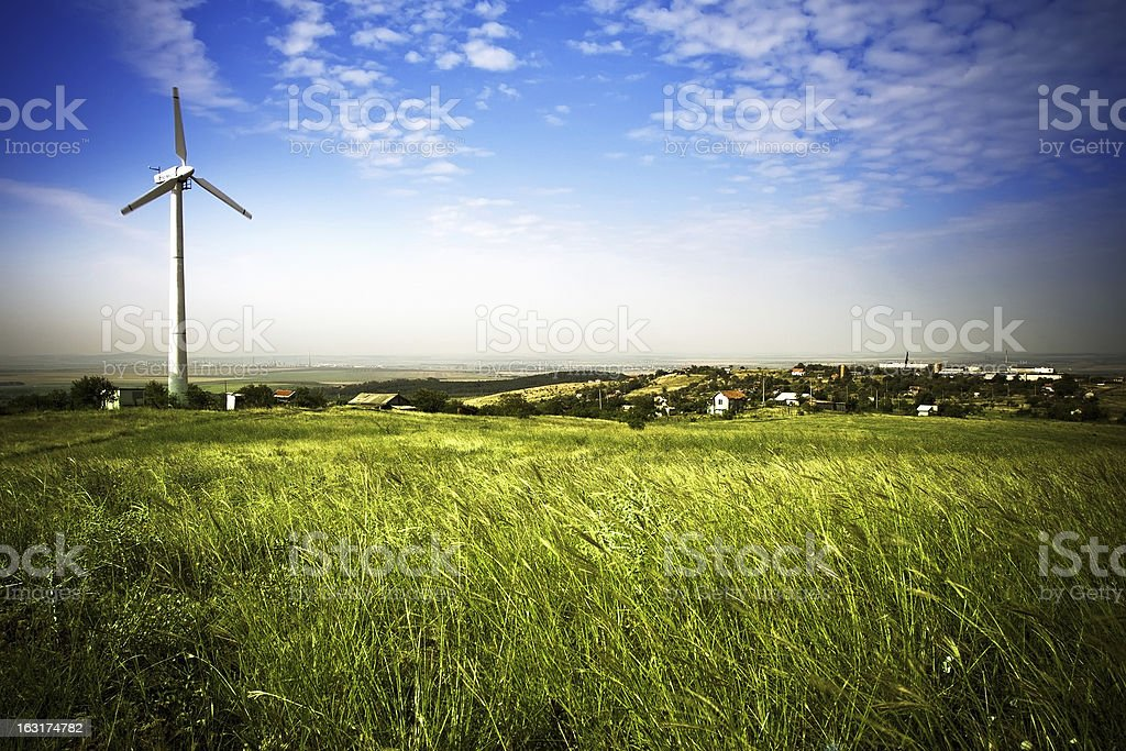 Beautiful field and wind turbine royalty-free stock photo