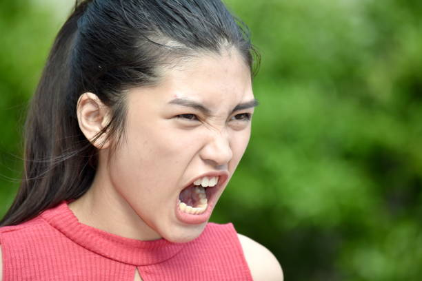A Beautiful Filipina Girl And Anger A person in an outdoor setting antagonize stock pictures, royalty-free photos & images