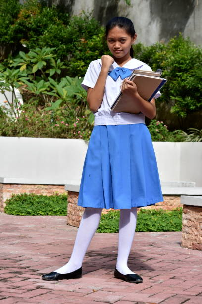 Beautiful Filipina School Girl And Anger With School Books A person in an outdoor setting antagonize stock pictures, royalty-free photos & images