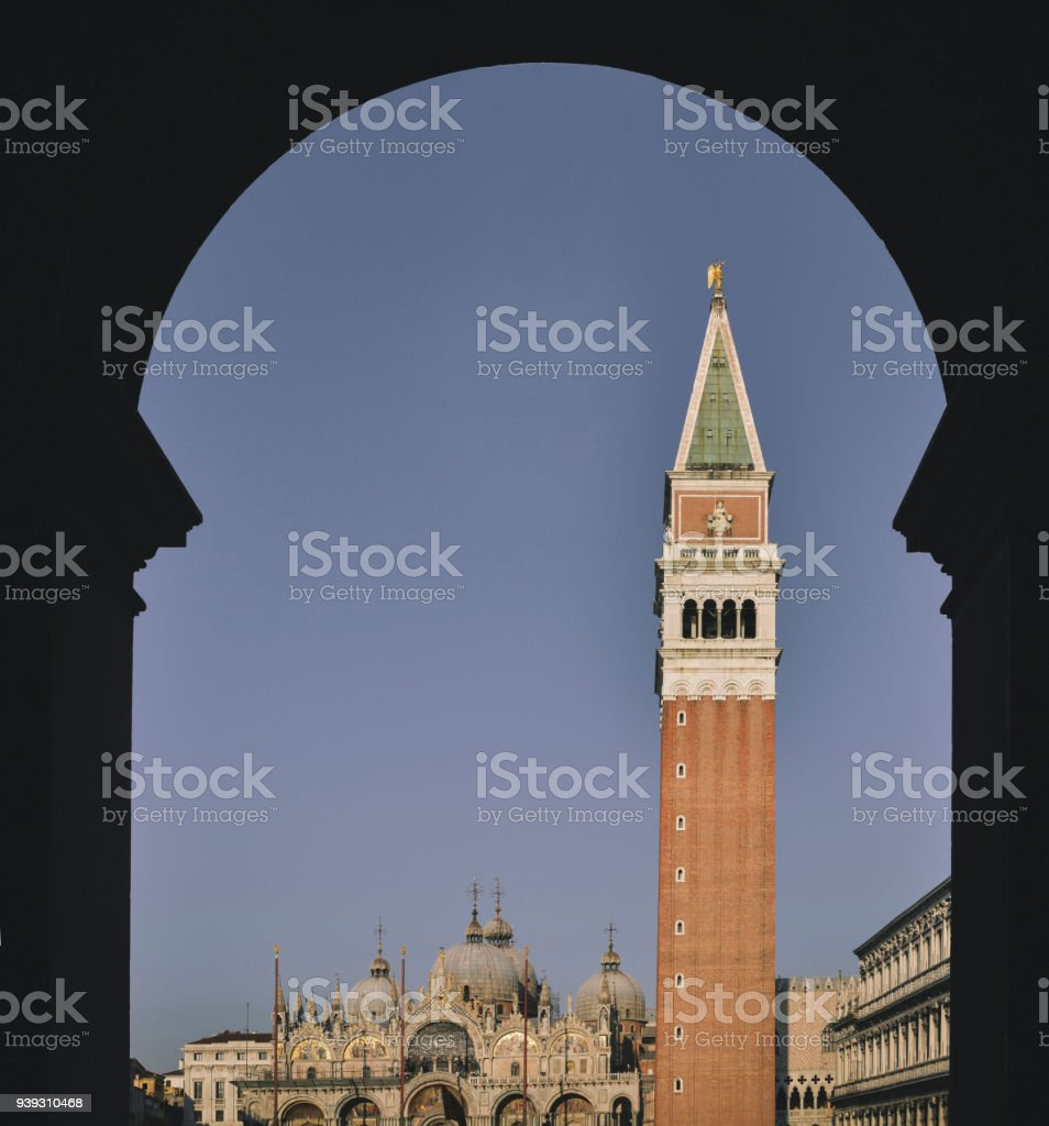 Beautiful fine art frame of Church of Saint Mark and St Mark's Campanile churchtower in Venice, Veneto, Italy. stock photo