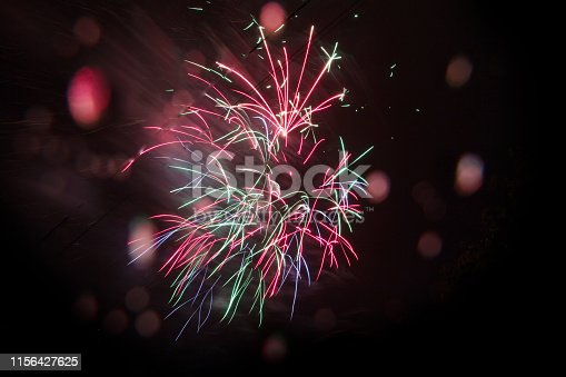 istock Beautiful fireworks at night. Great holiday of a great country. The celebration of Independence Day in the United States of America. 4th of July. 1156427625