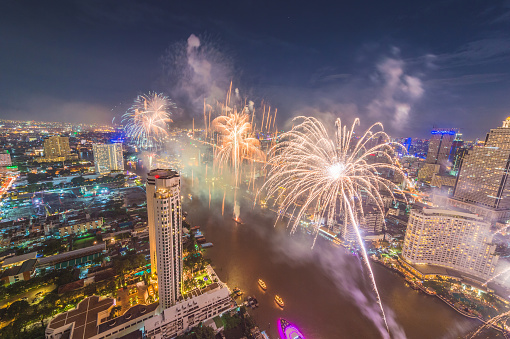 beautiful Fireworks celebrating over Chao Phraya river in Bangkok city at night, Thailand
