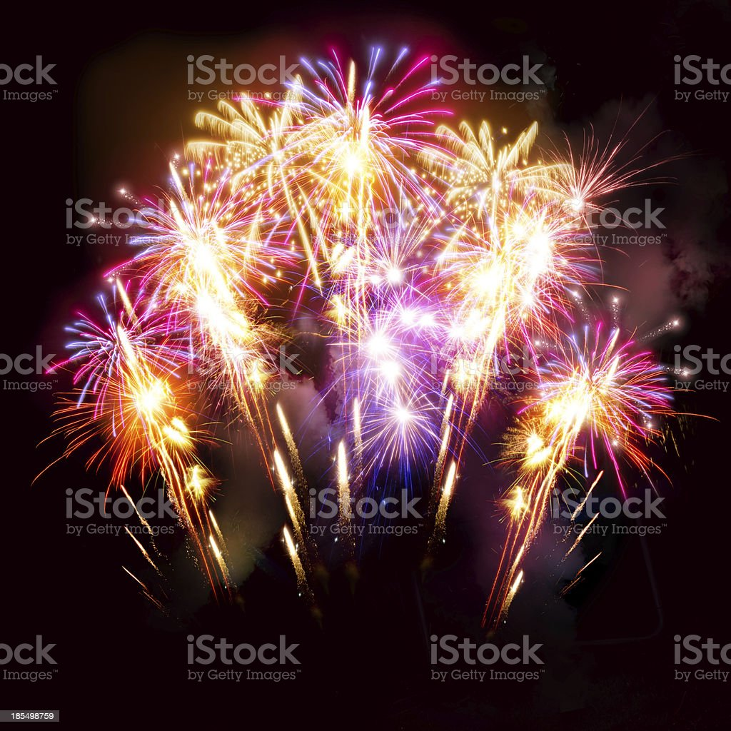 Colourful golden and pink fireworks display for celebrations.