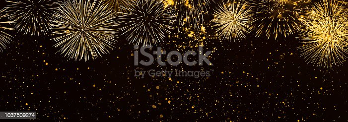 istock beautiful fireworks in the night background panorama 1037509274