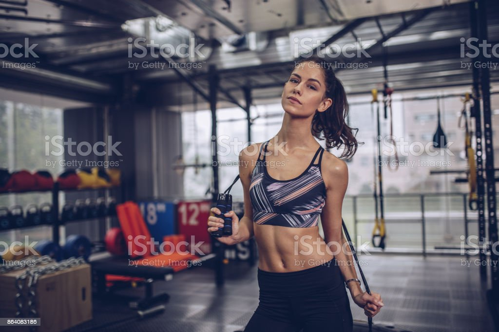 Beautiful fit woman in gym royalty-free stock photo