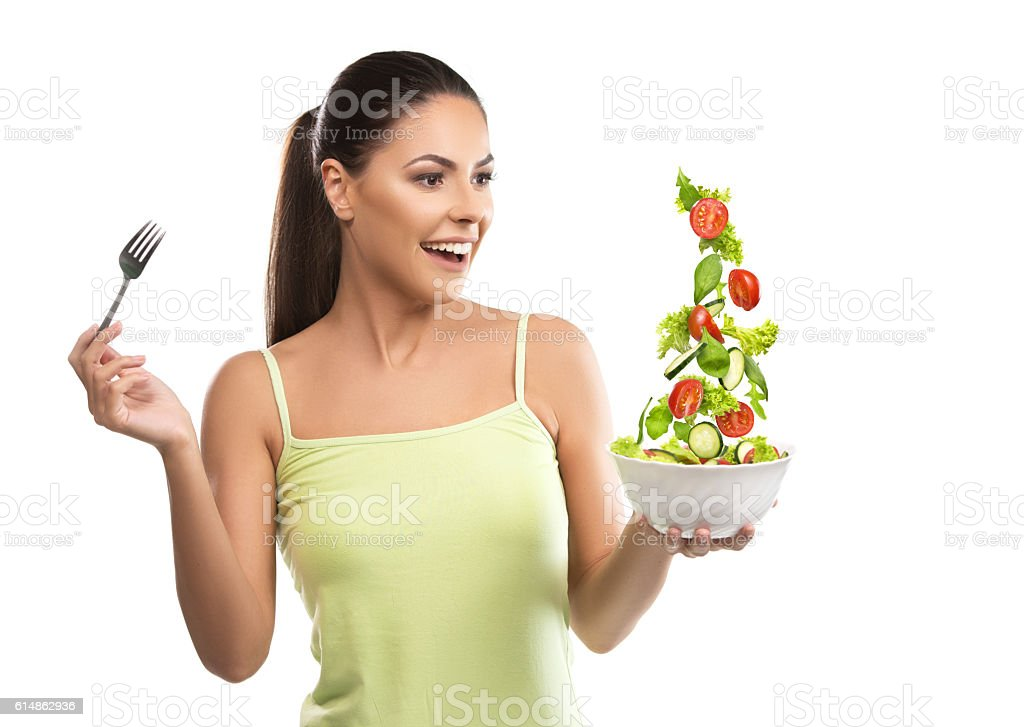 Beautiful, fit young woman holding a bowl of salad – Foto