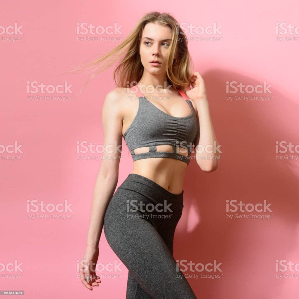 Beautiful fitness model girl posing wearing sport clothes stock photo