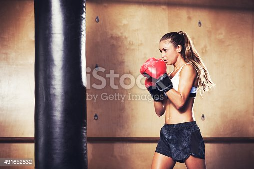 istock Beautiful Fitness Woman Boxing with Red Gloves 491652832