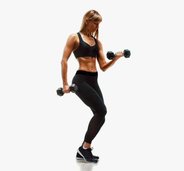 Beautiful Fitness Woman Exercise With Dumbbells stock photo