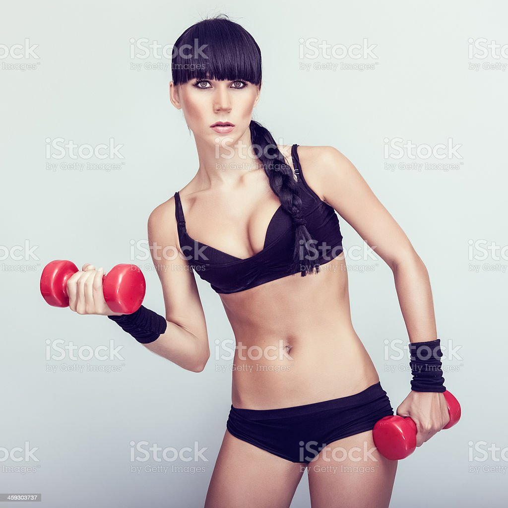 Beautiful  fitness woman exercising stock photo