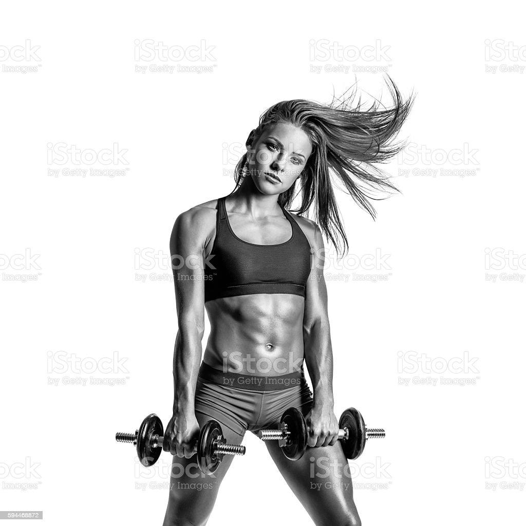 beautiful fitness woman posing on studio background stock photo