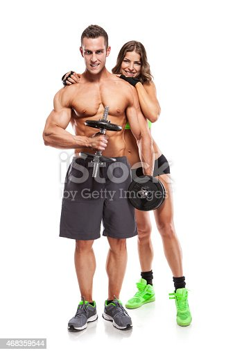 Beautiful Fitness Young Sporty Couple With Dumbbell Stock Photo & More Pictures of 2015