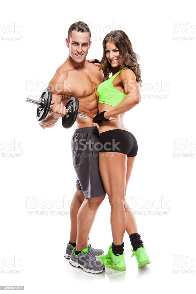 beautiful fitness young sporty couple with dumbbell royalty-free stock photo