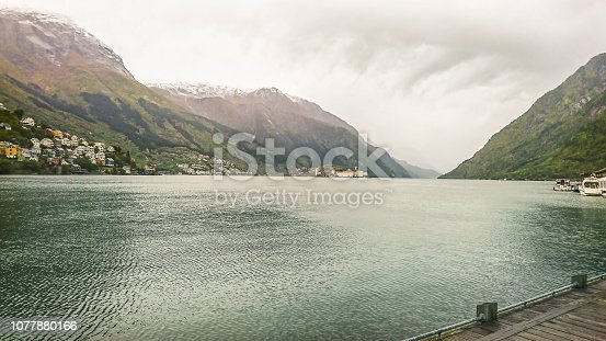 istock Beautiful fjord in autumn twilight, mountain peaks with first snow, small villages, Norway. 1077880166