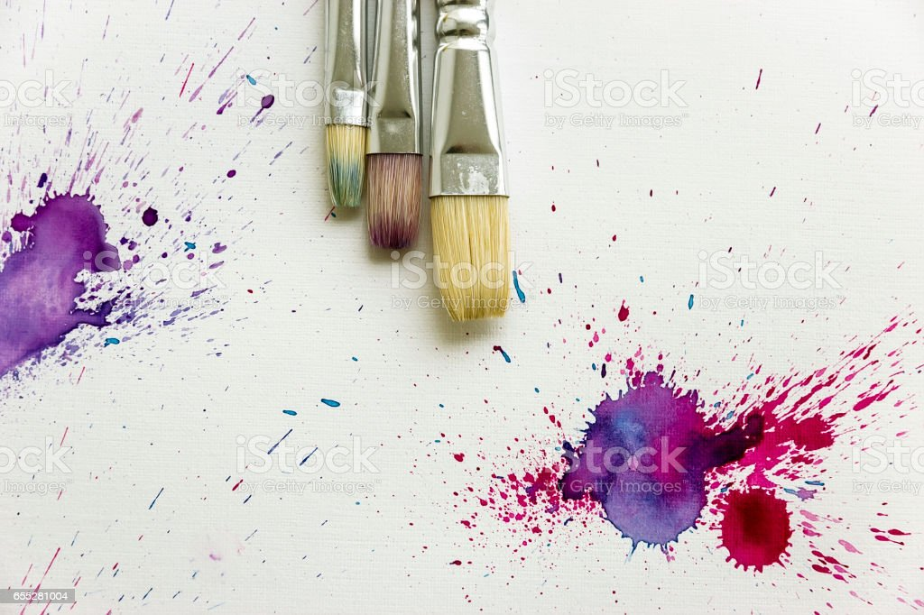 Beautiful Flat lay with Brushes and Watercolor splashe stock photo