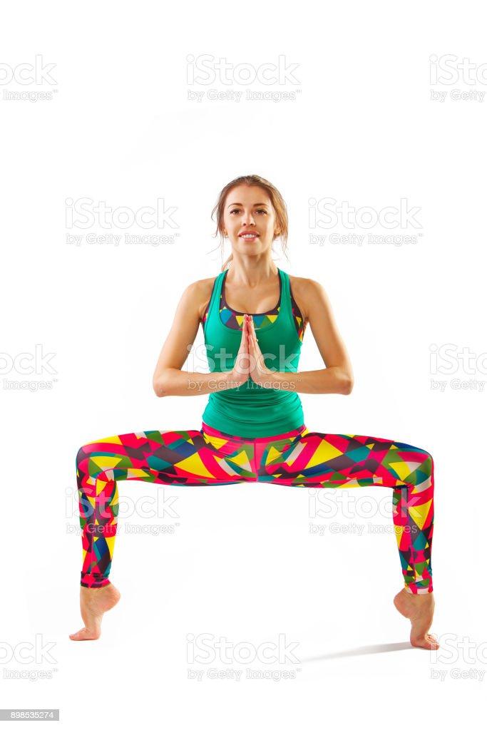 beautiful flexible woman doing yoga poses on white stock photo