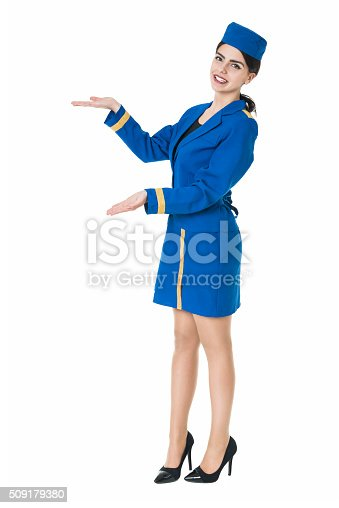 istock Beautiful Flight Attendant Stewardess how Presenting your Product 509179380
