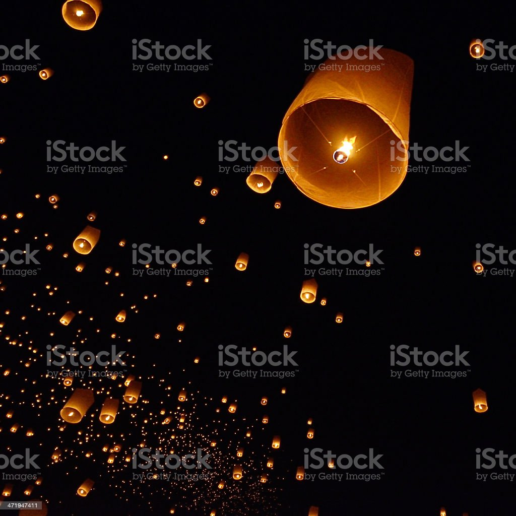 A beautiful floating lantern in a night sky stock photo