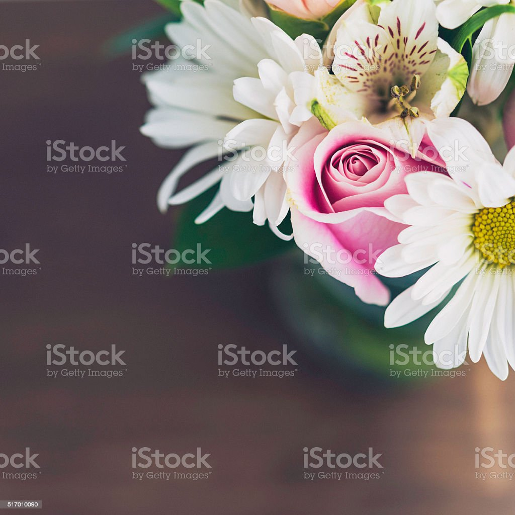 Beautiful floral bouquet in glass jar for Mother's Day stock photo