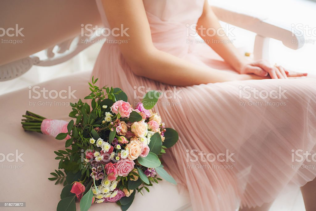 Beautiful floral composition near bride stock photo