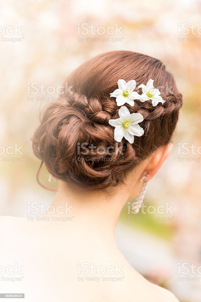 Beautiful flower detail in bride's hair royalty-free stock photo