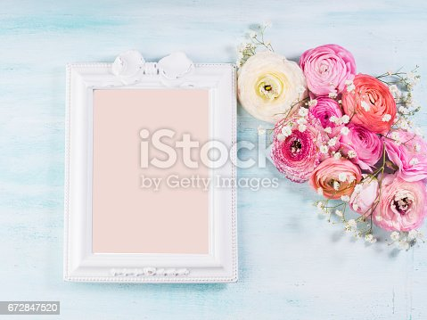 680461500istockphoto Beautiful flower frame bouquet on turquoise 672847520