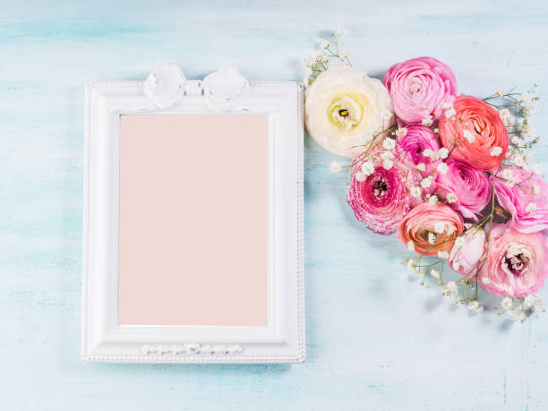 Beautiful flower frame bouquet on turquoise stock photo
