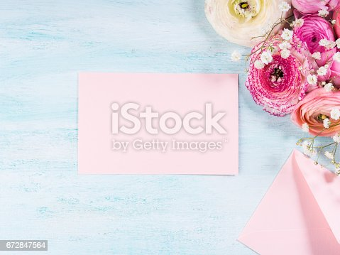 680461500istockphoto Beautiful flower frame bouquet on turquoise 672847564