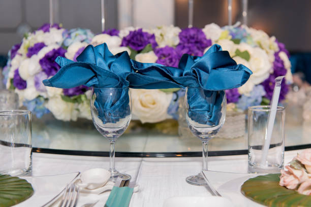 Beautiful flowers and Crystal goblet are placed on the table Beautiful flowers and Crystal goblet are placed on the table chinese wedding dinner stock pictures, royalty-free photos & images
