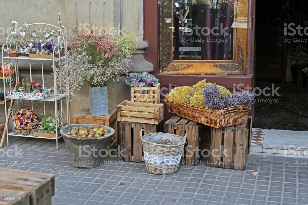 Beautiful flowers exhibited on the street near the flower shop in...