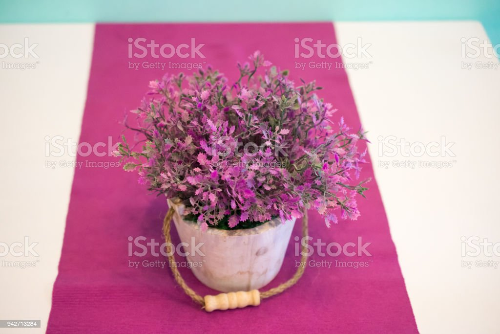 Beautiful Flowers In Vases On Table On Purple Table Cloth Background
