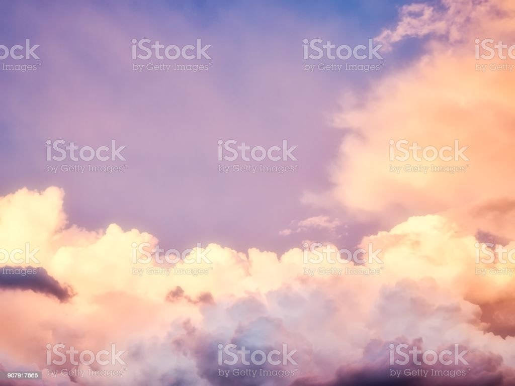 Beautiful Fluffy Clouds in Afternoon Sunlight. stock photo