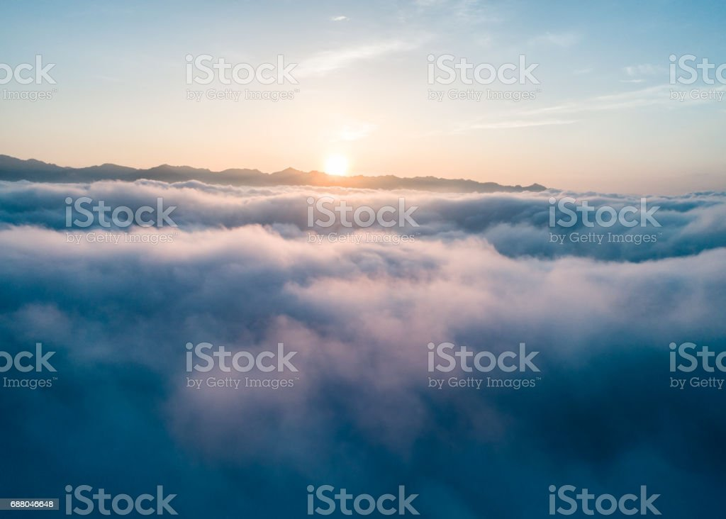 Beautiful Flying over the Clouds with the evening (morning) Sun. stock photo