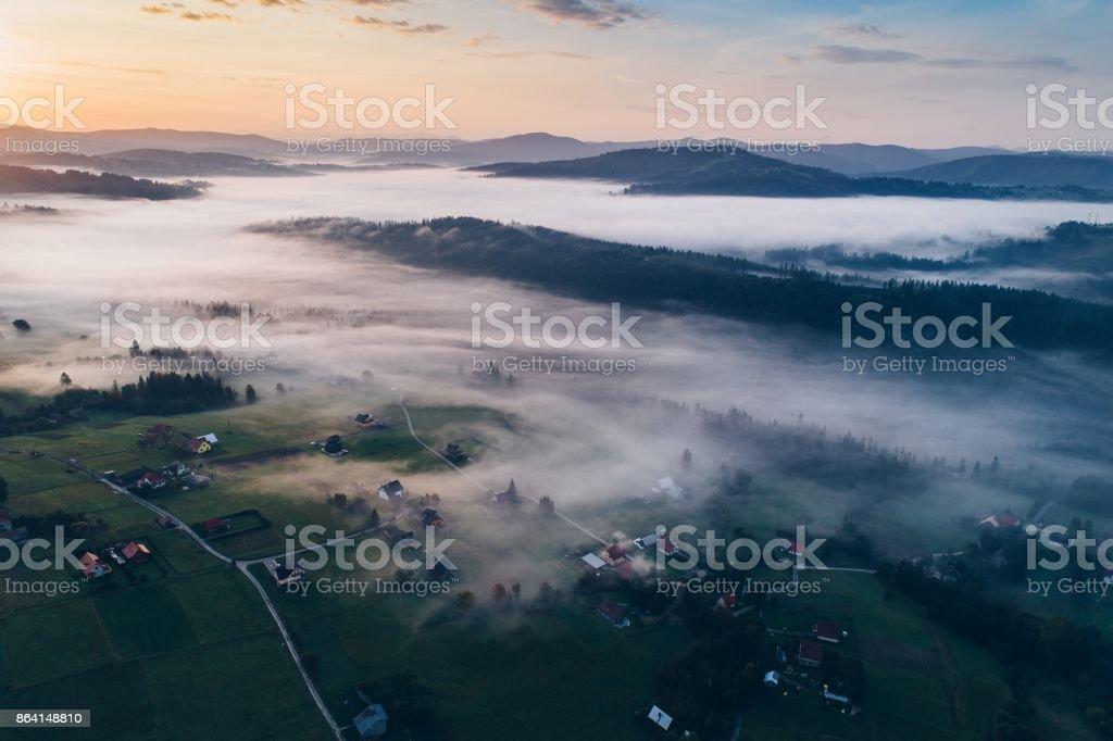 Beautiful foggy sunrise in mountains. royalty-free stock photo