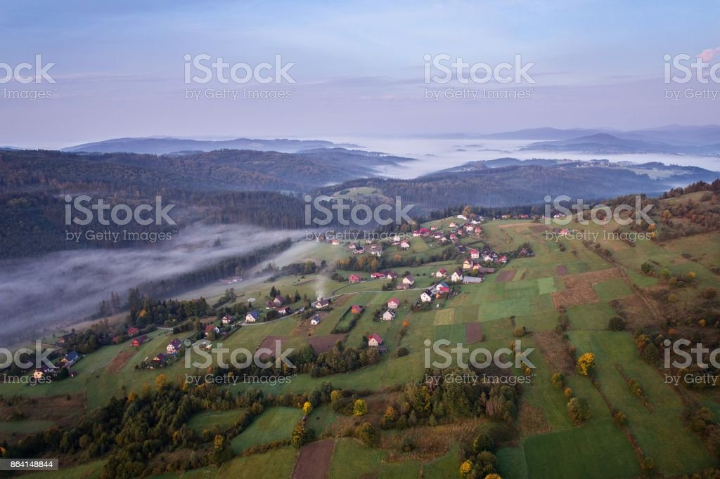 Beautiful foggy sunrise in mountains. royalty-free stock photo