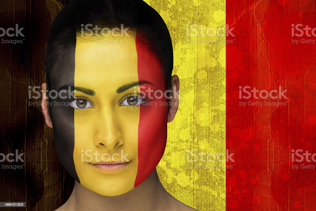 Beautiful football fan in face paint stock photo