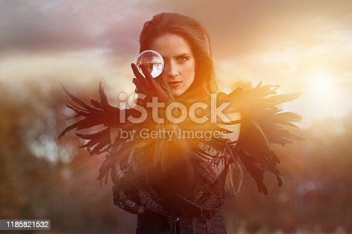 Beautiful Goth woman with crystal ball