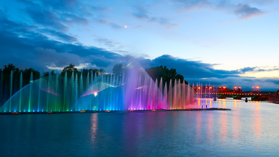 617378218 istock photo Beautiful fountain at night illuminated with blue light. Vinnyts 491485934