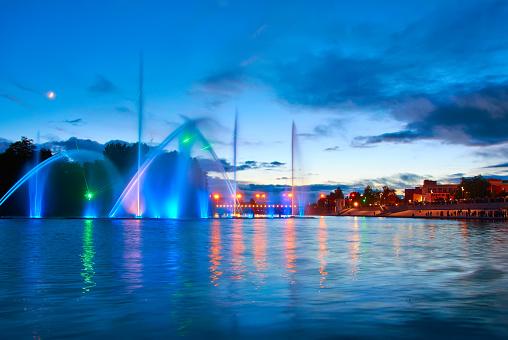 617378218 istock photo Beautiful fountain at night illuminated with blue light. Vinnyts 491485976
