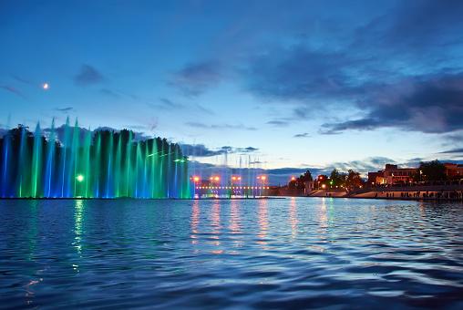 617378218 istock photo Beautiful fountain at night illuminated with blue light. Vinnyts 491486016