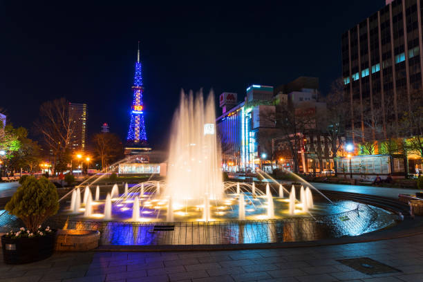 beautiful fountain in odori park - sapporo stock photos and pictures