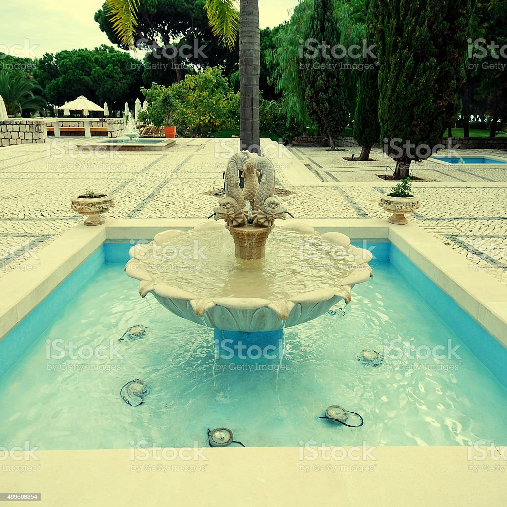 Beautiful fountain in scenic cobblestone patio, Algarve, Portuga stock photo