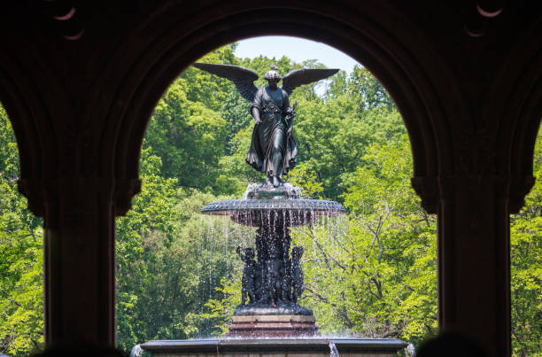 Beautiful Fountain Statue In The Summer Through Ornate Archway stock photo